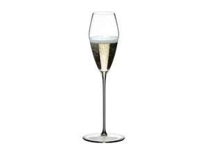 RIEDEL Max Champagne Glass filled with a drink on a white background