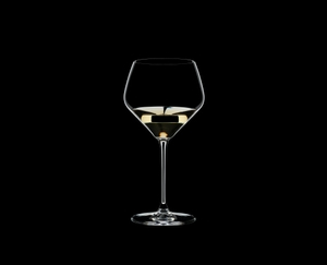 RIEDEL Extreme Restaurant Oaked Chardonnay filled with a drink on a black background
