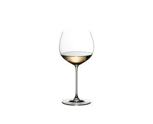 RIEDEL Veritas Restaurant Oaked Chardonnay filled with a drink on a white background
