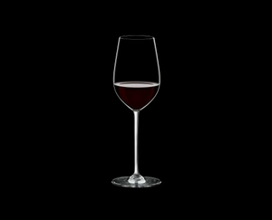 RIEDEL Fatto A Mano Riesling/Zinfandel White filled with a drink on a black background