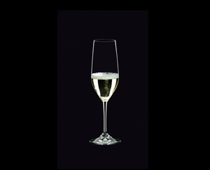 RIEDEL Degustazione Champagne Flute filled with a drink on a black background