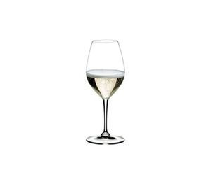 A RIEDEL Vinum Champagne Wine Glass filled with champagne on white background