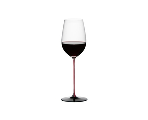 RIEDEL Black Series Collector's Edition Riesling Grand Cru filled with a drink on a white background