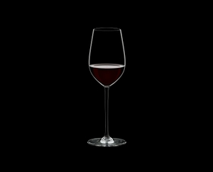 RIEDEL Fatto A Mano Riesling/Zinfandel Black filled with a drink on a black background