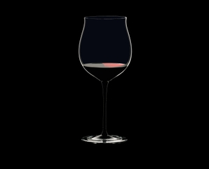 RIEDEL Sommeliers Black Tie Burgundy Grand Cru filled with a drink on a black background
