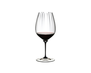 RIEDEL Fatto A Mano Performance Cabernet Black Stem filled with a drink on a white background