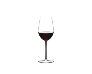 Red wine filled RIEDEL Sommeliers Riesling Grand Cru/Zinfandel glass on white background