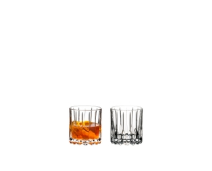 RIEDEL Drink Specific Glassware Neat filled with a drink on a white background