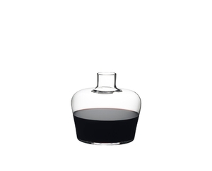 RIEDEL Decanter Margaux filled with a drink on a white background