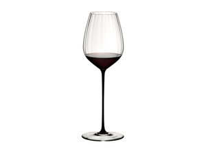 RIEDEL High Performance Cabernet Black filled with a drink on a white background