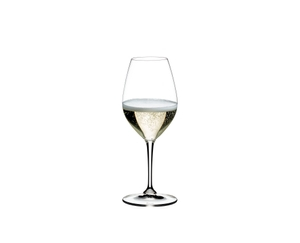 A filled RIEDEL Vinum Champagne Wine Glass on white background