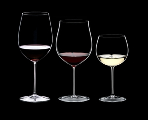 RIEDEL Sommeliers Tasting Set R.Q. filled with a drink on a black background