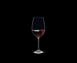 RIEDEL Vinum Restaurant Riesling Grand Cru/Zinfandel filled with a drink on a black background
