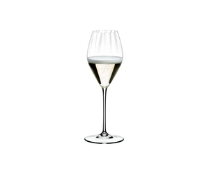 A RIEDEL Performance Champagne Glass filled with champagne on white background