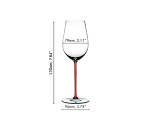A RIEDEL Fatto A Mano Riesling Red with a red stem and filled with white wine on a white background.