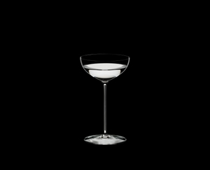 RIEDEL Superleggero Coupe/Cocktail filled with a drink on a black background