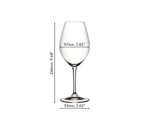 A RIEDEL Ouverture Marie-Jeanne Glass filled with white wine on a white background.
