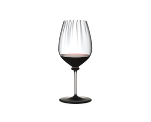 RIEDEL Fatto A Mano Performance Cabernet Black Base filled with a drink on a white background