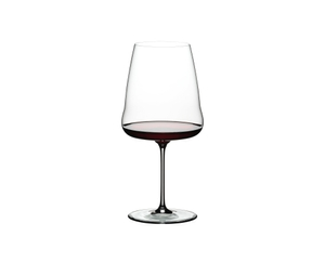 Red wine filled RIEDEL Winewings Cabernet Sauvignon glass on white background