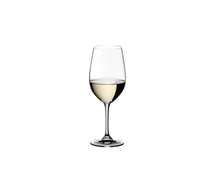 RIEDEL Vinum Riesling Grand Cru/Zinfandel glass filled with white wine on white background