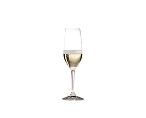 RIEDEL Degustazione Champagne Flute filled with a drink on a white background