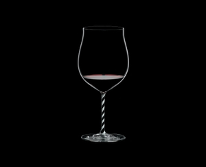RIEDEL Fatto A Mano Burgundy Grand Cru Black & White filled with a drink on a black background