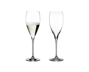 Two RIEDEL Vinum Vintage Champagne Glasses. One is unfilled, the other one is filled with Champagne.