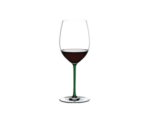 RIEDEL Fatto A Mano R.Q. Cabernet/Merlot Green filled with a drink on a white background