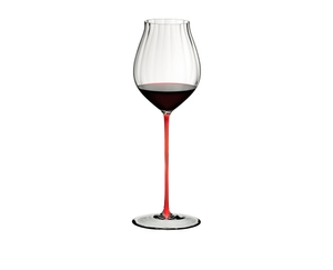 A RIEDEL High Performance Pinot Noir Red glass filled with red wine on white background