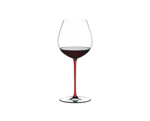 A RIEDEL Fatto A Mano Pinot Noir glass with a red stem and filled with red wine.