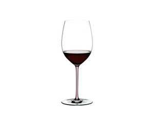 RIEDEL Fatto A Mano Cabernet Pink filled with a drink on a white background
