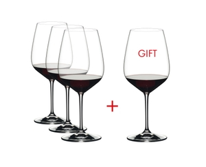RIEDEL Extreme Cabernet filled with a drink on a white background