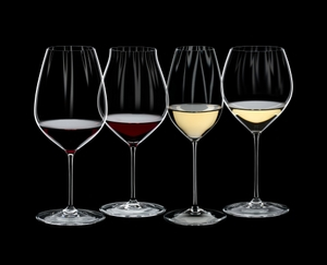 RIEDEL Performance Tasting Set filled with a drink on a black background