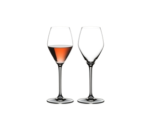 Two RIEDEL Extreme Rosé Wine / Rosé Champagne Glasses. One is unfilled, the other one is filled with Rosé Champagne.