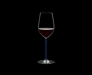 RIEDEL Fatto A Mano Riesling/Zinfandel Dark Blue filled with a drink on a black background