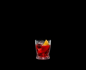 RIEDEL Tumbler Collection Fire Whisky filled with a drink on a black background