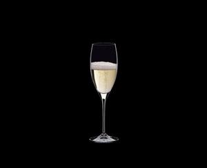 RIEDEL Vinum Restaurant Cuvée Prestige filled with a drink on a black background