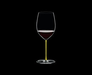 RIEDEL Fatto A Mano R.Q. Cabernet/Merlot Yellow filled with a drink on a black background