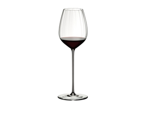 RIEDEL High Performance Cabernet Clear filled with a drink on a white background
