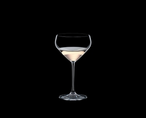 RIEDEL Extreme Junmai filled with a drink on a black background
