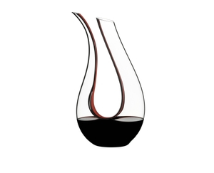 RIEDEL Decanter Amadeo Double Magnum filled with a drink on a white background