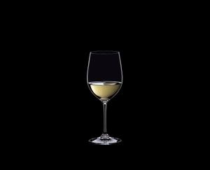 RIEDEL Vinum Restaurant Viognier/Chardonnay filled with a drink on a black background
