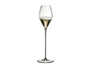 RIEDEL High Performance Champagne Glass Clear filled with a drink on a white background