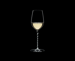 RIEDEL Fatto A Mano Riesling/Zinfandel Black & White filled with a drink on a black background