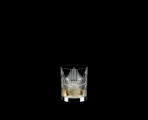 RIEDEL Tumbler Collection Shadows Tumbler filled with a drink on a black background