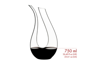 Red wine is being poured from a RIEDEL Amadeo Decanter into a RIEDEL Veritas Cabernet/Merlot glass