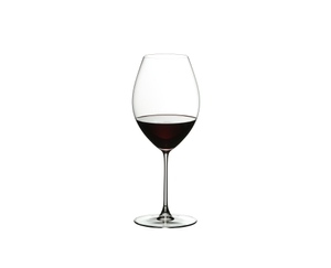 A red wine filled RIEDEL Veritas Old World Syrah glass on white background