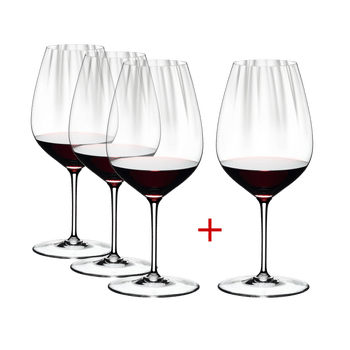 RIEDEL Performance Cabernet/Merlot filled with a drink on a white background