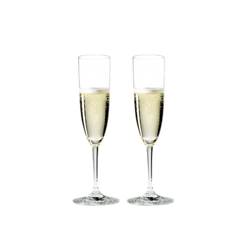 RIEDEL Vinum Champagne Glass filled with a drink on a white background