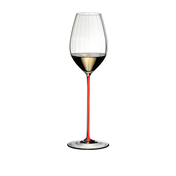 RIEDEL High Performance Riesling Red filled with a drink on a white background